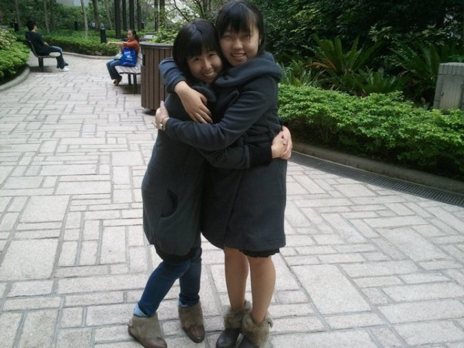 omg me and charlene in year 1!!! outside medical library with matching outfits!!!! hahahha we have been through a lot together my dear sis <3